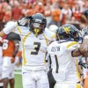 No. 4 West Virginia holds off No. 15 Longhorns in 48-45 shootout on the road
